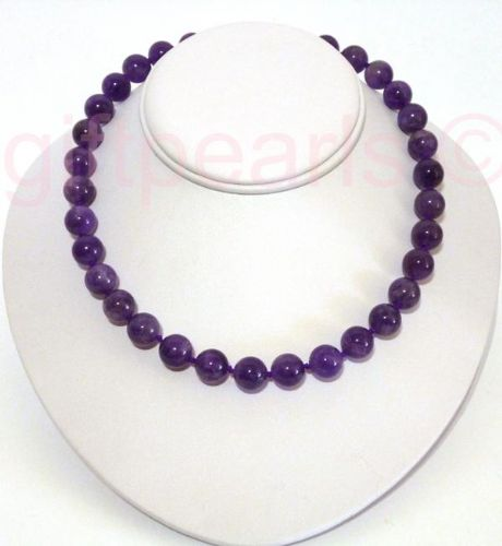 Amethyst necklace with golden, crystal-studded magnetic clasp.